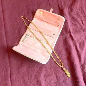 Gold necklace and makeup bag